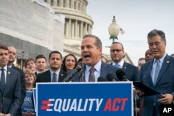 Rep. David Cicilline, D-R.I., joined at right by Chad Griffin, president of the Human Rights Campaign, and Rep. Mark Takano, D-Calif., speaks before a House vote on the Equality Act of 2019, which would extend anti-discrimination protections to LGBT Ameri
