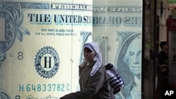 An Egyptian walks in front of a closed currency exchange in Cairo (file photo - January 31, 2011)