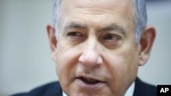 Israeli Prime Minister Benjamin Netanyahu chairs the weekly cabinet meeting at his office in Jerusalem, June. 30, 2019.