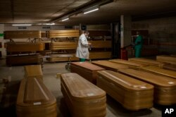 Coffins with the bodies of coronavirus victims are stored waiting for burial or cremation at the Collserola morgue in Barcelona, Spain, April 2, 2020.