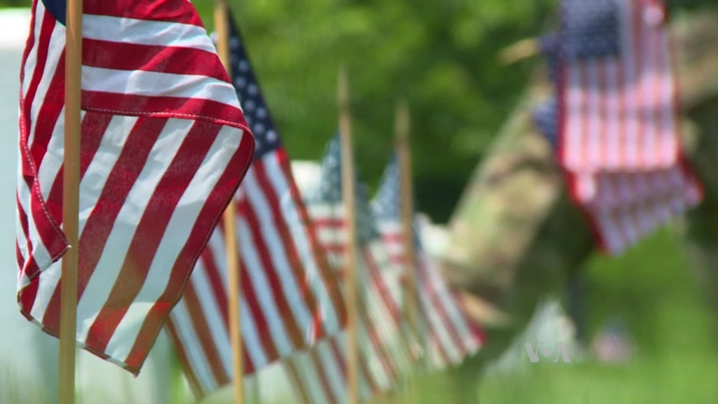 US Military's Fallen Honored With Flags