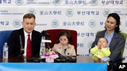 Robert Kelly, left, a political science professor at Pusan National University, holds a press conference with his wife Jung-a Kim, right, and children James and Marion at the university in Busan, South Korea, Wednesday, March 15, 2017.