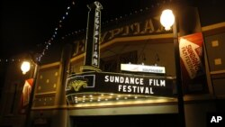 FILE - The marquee at the Egyptian Theatre on Main Street is seen at night during the 2013 Sundance Film Festival in Park City, Utah, Jan. 17, 2013.