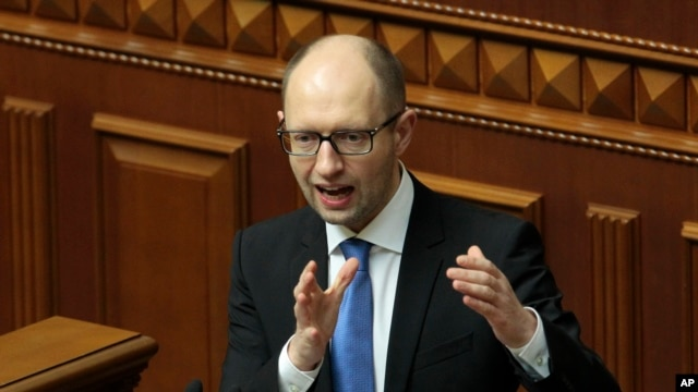 Ukrainian Prime Minister Arseniy Yatsenyuk, speaks to lawmakers during a session at the Ukrainian parliament in Kyiv.
