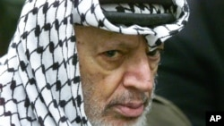 FILE - Palestinian leader Yasser Arafat pauses during the weekly Muslim Friday prayers in his headquarters in the West Bank city of Ramallah, May 31, 2002.