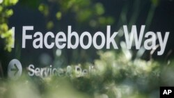 In this April 25, 2019 file photo, an address sign for Facebook Way is shown in Menlo Park, Calif. (AP Photo/Jeff Chiu, File)
