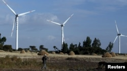 A man walks near the Adama wind farm project built by Chinese Exim bank on the outskirt of Adama Town, east of the capital Addis Ababa, Nov. 5, 2015.