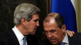 U.S. Secretary of State John Kerry, left, during joint news conference with Russia's Foreign Minister Sergei Lavrov, Moscow, May 7, 2013.