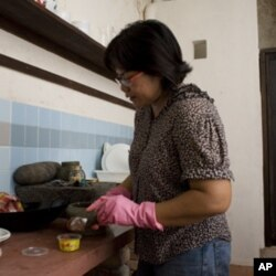 Nazlina Hussin preparing ingredients for her cooking class that is held in a rented pre-war shop house in Georgetown, Penang.