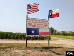 Brownsville, Texas resident Pamela Taylor erected a sign outside her property in protest of the 2006 Secure Fence Act. Although she voted for President Trump in 2016, her philosophy on his plans to build a continuous wall remain unchanged. (R. Taylor/VOA)