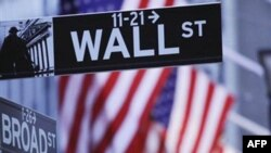 Wall Street and the New York Stock Exchange are shown, Tuesday, Aug. 9, 2011 in New York. Stocks tanked again Tuesday as many global markets entered official bear market territory after one of the worst days on Wall Street since the collapse of Lehman Bro