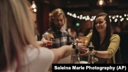 In this January 17, 2019 photo, a bartender serves patrons Rae of Sunshine mocktails at Sans Bar pop up bar at The Factory Luxe in Seattle, a Marnie Rae launch party for National Mocktail Week.