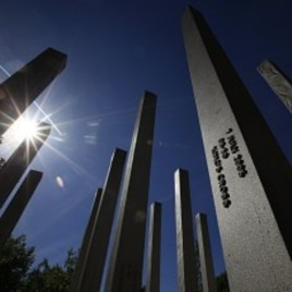 Sunshine reflects from the pillars of the memorial to the victims of the July 7, 2005 London bombings, in Hyde Park, central London May 2, 2011