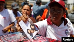 Supporters of Venezuelan President Hugo Chavez line up to put encouraging messages for him in a box outside the military hospital in Caracas Mar. 5, 2013.