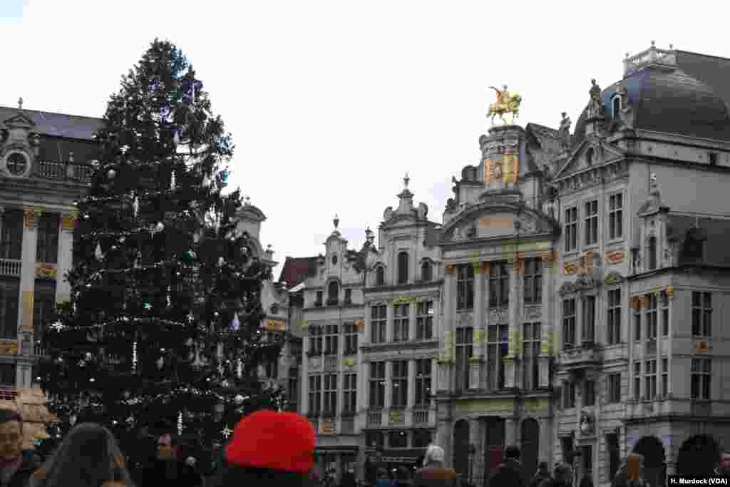 Despite terrorist fears some tourists enjoy Brussels' spectacular buildings. The heavy security presence gets as much attention from tourists as the sights.