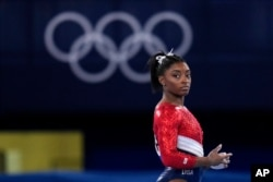 Simone Biles, of the United States, waits to perform on the vault during the artistic gymnastics women's final at the 2020 Summer Olympics, July 27, 2021, in Tokyo.