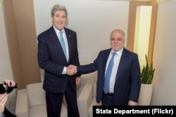 U.S. Secretary of State John Kerry shakes hands with Iraqi Prime Minister Haider al-Abadi before a bilateral meeting amid the World Economic Forum in Davos, Switzerland, Jan. 21, 2016.