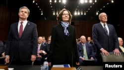From left, FBI Director Christopher Wray, CIA Director Gina Haspel and Director of National Intelligence Dan Coats testify before a Senate Intelligence Committee hearing January 29, 2019. (REUTERS/Joshua Roberts)