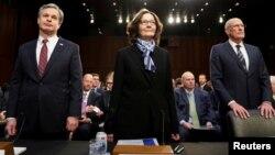 Директор ФБР Крістофер Рей; директор ЦРУ Джина Гаспел, та директор Національної ровідки Ден Коутс