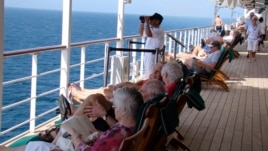 A watchkeeper is seen on the deck of the Queen Mary 2 in the southern Red Sea, January 24, 2013.