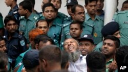 A border guard who was sentenced to death reacts as he leaves a special court in Dhaka, Nov. 5, 2013.