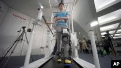 Toyota's robotic leg brace is designed to help partially paralyzed people walk.