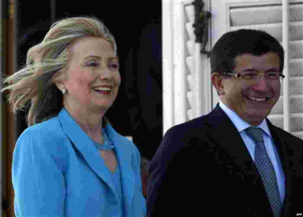 U. S. Secretary of State Hillary Rodham Clinton and her Turkish counterpart Ahmet Davutoglu arrive to address the media after their talks in Istanbul, Turkey, Saturday, July 16, 2011. (AP Photo/Burhan Ozbilici)