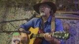 Michael Fox singing at the Oatman Hotel