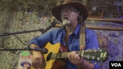 Michael Fox singing at the Oatman Hotel