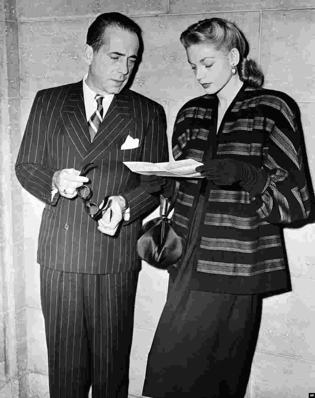 US actor Humphrey Bogart and his actress wife, Lauren Bacall, attend a dinner at the Biltmore Bowl, Hollywood, Los Angeles, California, United States, on Dec. 9, 1946. (AP Photo)
