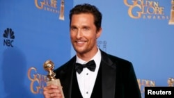 "Actor Matthew McConaughey poses backstage with his award for Best Actor in a Motion Picture, Drama for his role in ""Dallas Buyers Club"" at the 71st annual Golden Globe Awards in Beverly Hills, California, Jan. 12, 2014."