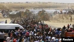 Milhares de sírios passando a fronteira paera a Turquia. 10 Junho 2015