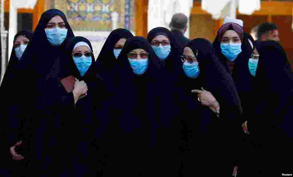 Shi'ite Muslims women wear protective face masks at Imam Ali Shrine, following an outbreak of coronavirus, in the holy city of Najaf, Iraq.