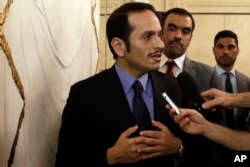 FILE - Qatar's foreign minister, Sheikh Mohammed bin Abdulrahman Al Thani, talks to journalists in Rome, July 1, 2017.