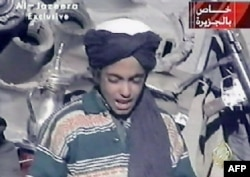 FILE - Hamza bin Laden, son of al-Qaida founder Osama bin Laden, is shown in this frame grab taken from the Al Jazeera news channel, Nov. 7, 2001. Hamza bin Laden has been trying to ease tensions with Islamic State in an effort to encourage the merger of IS fighters into al-Qaida.