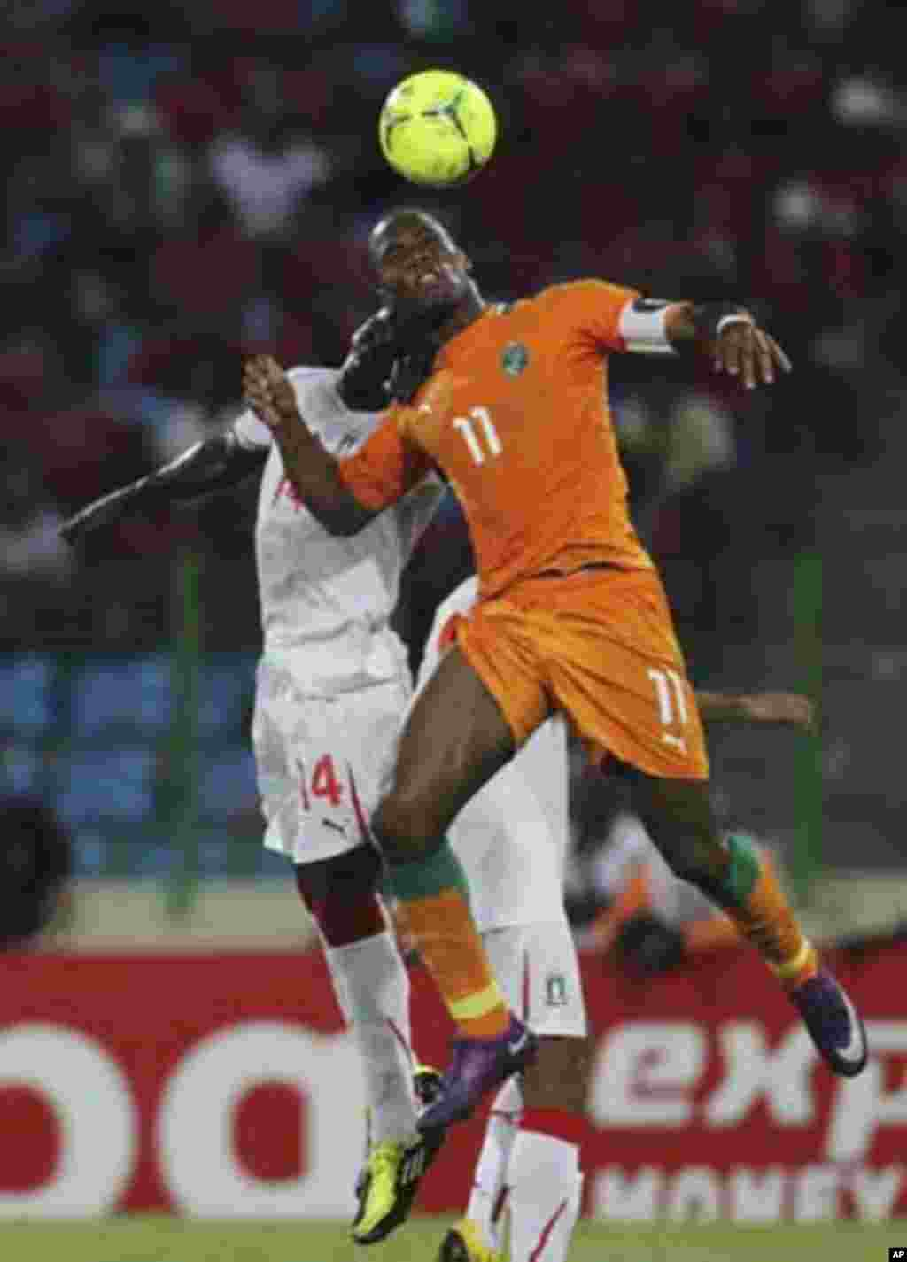 Didier Drogba (R) of Ivory Coast fights for the ball with Ben Konate of Equatorial Guinea during their quarter-final match at the African Nations Cup soccer tournament in Malabo February 4, 2012.