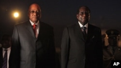 Election History: President Robert Mugabe, right, welcomed South African President Jacob Zuma, left, at Harare International airport, Thursday, Aug. 27, 2009.
