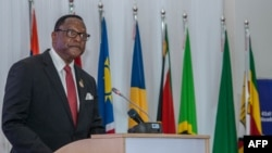Malawi President Lazarus Chakwera makes an acceptance speech after taking over the Southern African Development Community (SADC) Chairmanship, in Lilongwe, Malawi, on Aug. 17, 2021.
