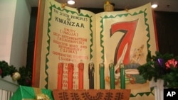 FILE - The seven tenets of Kwanzaa are unity, self-determination, collective work and responsibility, cooperative economics, purpose, creativity and faith.