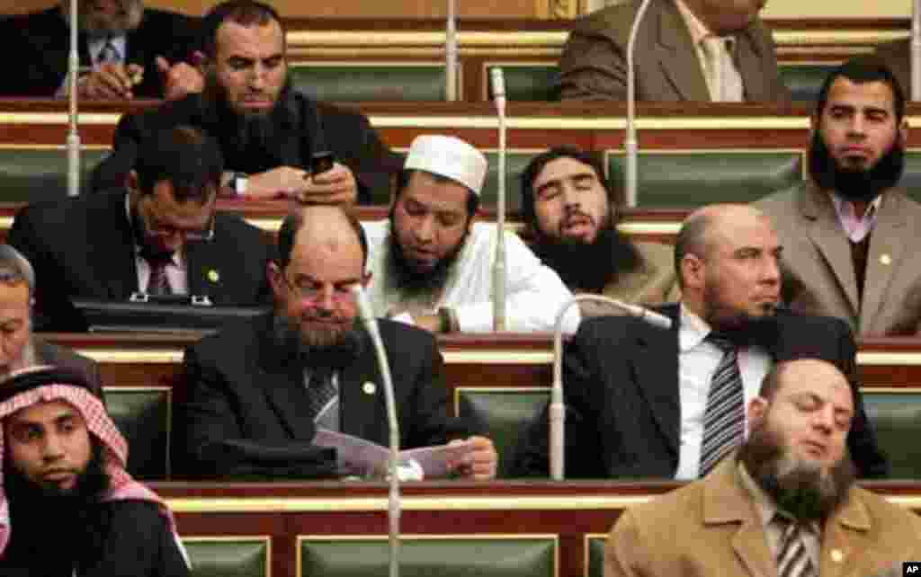 Salafi members of parliament are seen during the first Egyptian parliament session, after a revolution ousted former President Hosni Mubarak, in Cairo January 23, 2012. Egypt's parliament opened on Monday for the first time since a historic free election