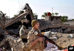 """FILE - Iraqi soldiers retook Ramadi, but rebuilding is crucial. """"Without a political strategy, there is only a military victory which can and will only be transient,"""" a former Iraqi official said."""