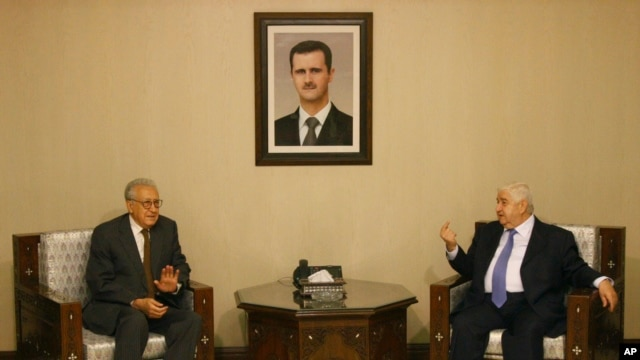 Progress in rebel efforts to create alternative government has been stalled by some in Syrian National Coalition who believe another route to peace may be achieved by UN-Arab League special envoy to Syria Lakhdar Brahimi, shown here with Syria's foreign minister, Walid Mouallem. on September 13, 2012.  (AP)