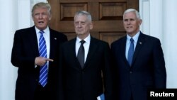 U.S. President-elect Donald Trump (L) and Vice President-elect Mike Pence (R) greet retired Marine General James Mattis in Bedminster, New Jersey, Nov. 19, 2016. Trump has tapped Mattis to lead the Defense Department.