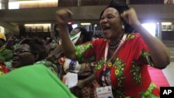 FILE: A woman reacts after Emmerson Mnangagwa was announced as one of the two vice Presidents at the Zanu pf headquarters in Harare,Wednesday, Dec, 10, 2014. (AP Photo/Tsvangirayi Mukwazhi)
