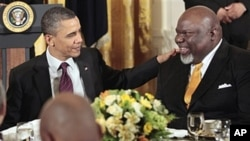 President Barack Obama talks with Texas-based evangelist Bishop T.D. Jakes during a Easter Prayer breakfast with Christian leaders in the East Room of the White House, April 19, 2011