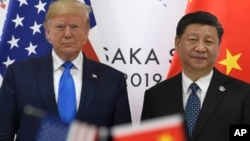 美国总统特朗普和中国国家主席习近平2019年6月29日在日本大阪G20峰会间隙举行会谈前合影