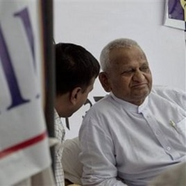 Indian social activist Anna Hazare, right, looks on during his hunger strike against corruption, in New Delhi, India, April 7, 2011