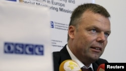 FILE - Deputy Chief of the Special Monitoring Mission of the Organization for Security and Cooperation (OSCE) to Ukraine Alexander Hug speaks during a news conference in Donetsk, Ukraine, July 24, 2015.
