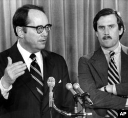 Pennsylvania Gov. Dick Thornburgh, left, announces the closing of schools around the Three Mile Island Nuclear Power Plant on March 30, 1979.