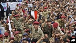 Yemeni army soldiers who defected are lifted by anti-government protestors during a demonstration demanding the resignation of President Ali Abdullah Saleh, in Sanaa, Yemen, June 15, 2011